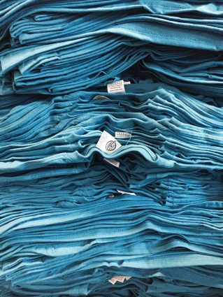 Stack of blue t-shirts - Marshall Atkinson